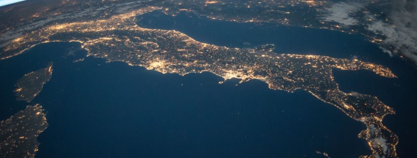 An image from outer-space at night showing the lights in Italy