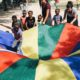 Children Playing with a parachute in Haiti