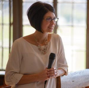 woman at podium listening