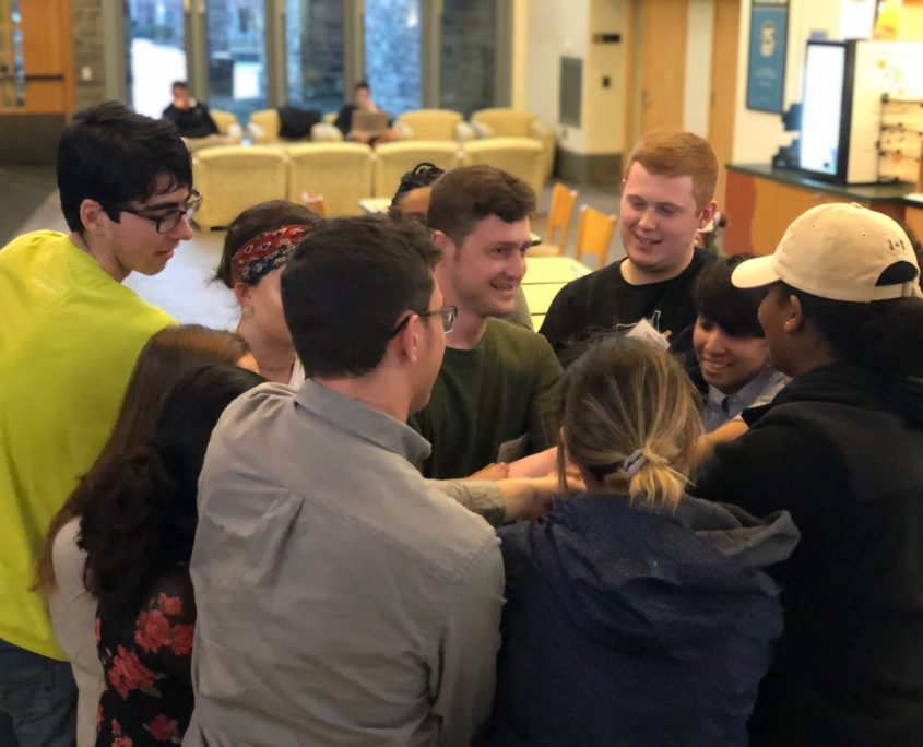 The Social Impact Fellows learned about communication and teamwork with the human knot activity.