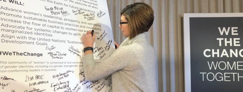 CEO of Mission Partners, Carrie Fox signing the WeTheChange declaration