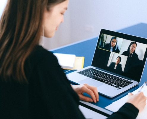 A woman at a virtual meeting