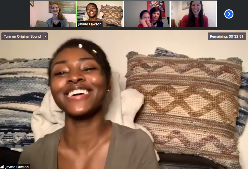 A screenshot of a zoom event showing a Black woman smiling